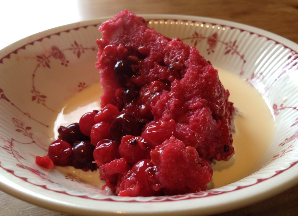 A slice of summer pudding with cream